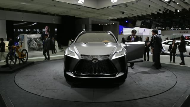 Toyota Motor Co Lexus IS 300h vehicle is displayed at the 43rd Tokyo Motor Show 2013 in Tokyo Japan on Wednesday Nov 20 Attendees look at the Toyota...