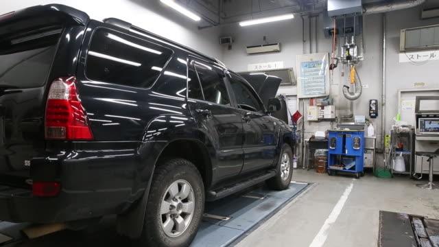 toyota motor corp 86 coupe sienta minivan chr sports utility vehicle prius phv plugin hybrid vehicle are displayed outside tokyo toyopet motor sales... - 機械工点の映像素材/bロール