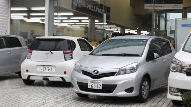 cs toyota motor corp badge displayed on the back of a vehicle outside toyota motor corp netz dealership in toyota city aichi prefecture japan on... - バッジ点の映像素材/bロール