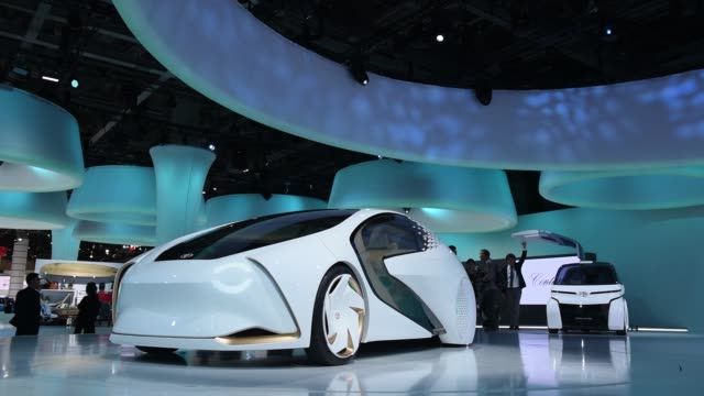 stockvideo's en b-roll-footage met a toyota motor corp concepti vehicle stands on display at the tokyo motor show in tokyo japan on wednesday oct 25 the illuminated interior of a... - toyota motor