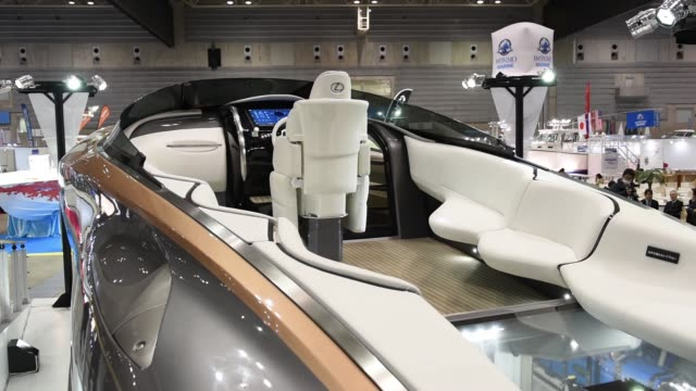 A Toyota Motor Corp Lexus Sport Yacht Concept above and a Lexus LC 500 vehicle stand on display at the Japan International Boat Show in Yokohama...