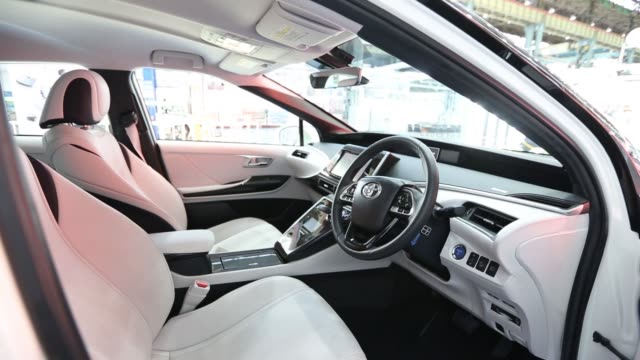 stockvideo's en b-roll-footage met a toyota motor corp mirai fuelcell vehicle stands in the inspection area on the production line of the company's motomachi plant in toyota city aichi... - toyota motor
