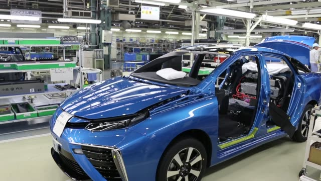 A Toyota Motor Corp worker inspects a bumper for the Mirai fuel cell vehicle on the production line of the companys Motomachi plant in Toyota Aichi...