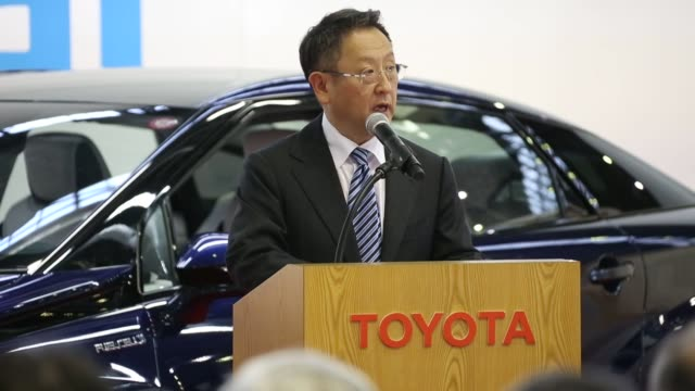 stockvideo's en b-roll-footage met toyota motor corp workers attend the line off ceremony for the mirai fuel cell vehicle at the companys motomachi plant in toyota, aichi prefecture,... - plant stage