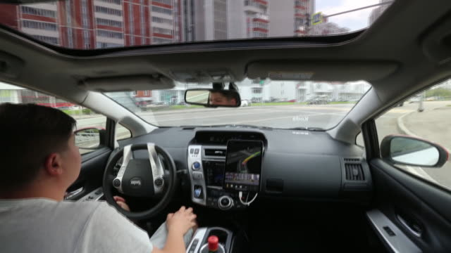 toyota prius and hyundai sonata selfdriving cars operated by the yandextaxi online service in moscow russia on sunday august 25 2019 - driverless car stock videos & royalty-free footage