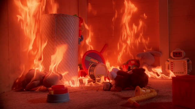 toys in a child's bedroom are engulfed in flames. - burning stock videos & royalty-free footage