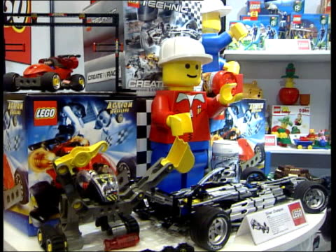 toys on display at london toy fair; england: london toy fair: int gvs toys on display & demonstrated at toy fair including: lego robots / table... - television show stock videos & royalty-free footage