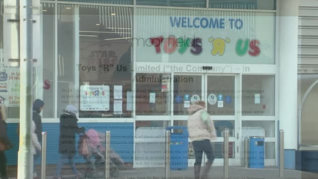 'toys r us' and 'maplin' go into administration; england: ext wide shot 'toys 'r' us' store with 'now open' sign 'toys 'r' us' now open!' sign... - toys r us stock videos & royalty-free footage