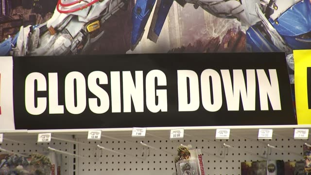 toys r us announces closure; england: london: brent cross: int 'everything must go' sign in toys r us shop 'closing down' and discount signs on... - toys r us stock videos & royalty-free footage