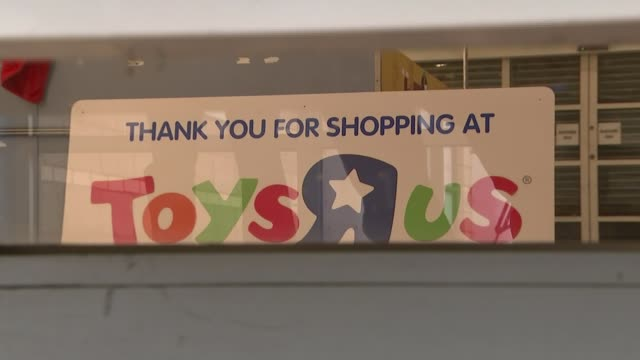 toys r us closes final uk stores / pressure on high street retailers; england: west midlands: coventry: ext various of staff member closing shutters... - toys r us stock videos & royalty-free footage