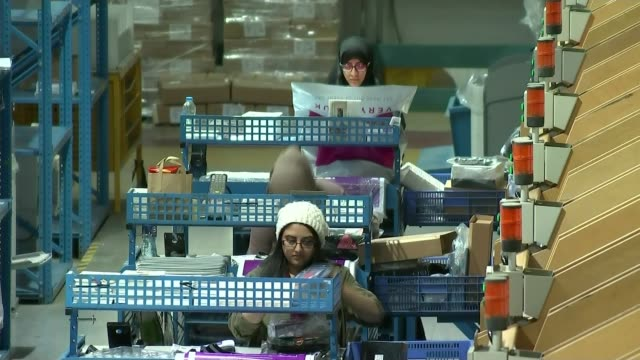 Toys R Us to close a quarter of its stores T25111646 / TX Oldham INT Workers packing orders in online distribution centre Items along conveyor belts