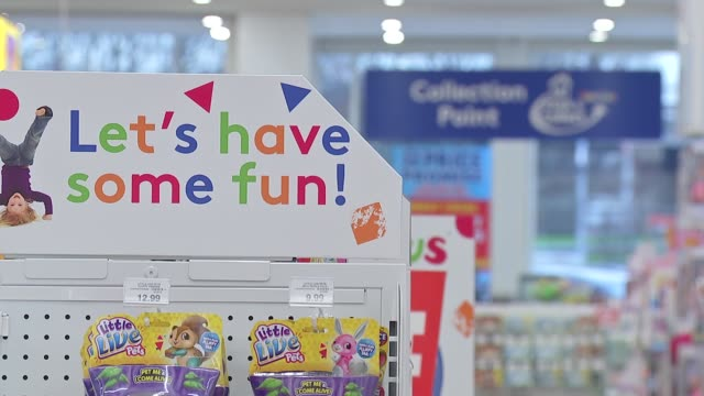toys-r-us set to close a quarter of its uk stores: toys r us store views; england: ext various views of toys r us store and customers pushing... - toys r us stock videos & royalty-free footage