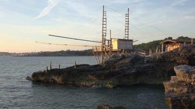 trabucco fishing machine at rocky coast at the adriatic sea - adriatic sea stock videos & royalty-free footage