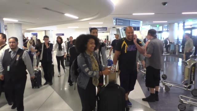 Tracee Ellis Ross Marcus Scribner and Yara Shahidi at Los Angeles International Airport at Celebrity Sightings in Los Angeles on August 26 2016 in...