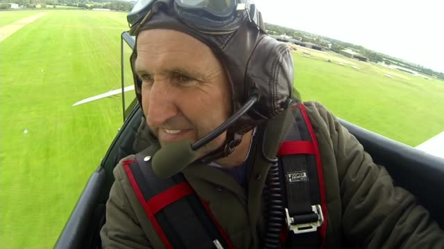 tracey curtistaylor approaches end of flight to australia lib / 3092015 west sussex goodwood reporter sat in cockpit of biplane as aircraft takes off... - goodwood stock videos and b-roll footage