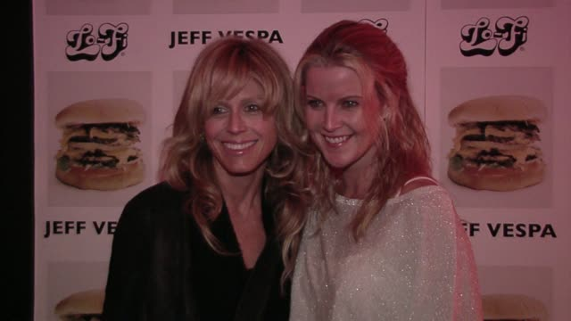 Tracey Ross and Maeve Quinlan at the Jeff Vespa's Eat Me Art Show Opening at the LoFi Gallery in Los Angeles California on May 4 2006