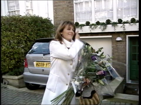 GMC inquiry father interview LIB EXT Actress Liz Hurley posing with bouquet Duchess of York Sarah Ferguson along holding baby next husband Prince...