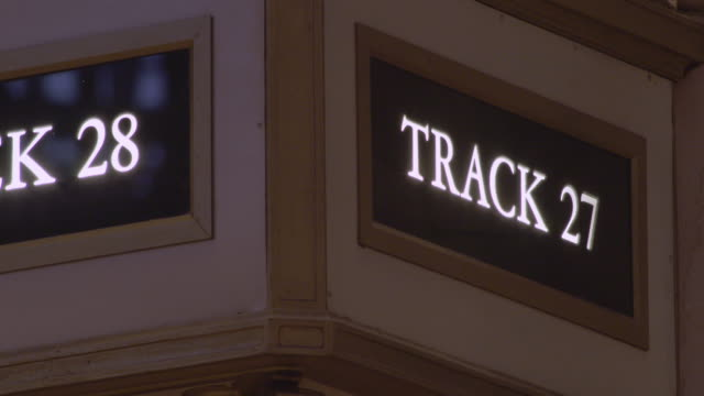 track 27 and 28 sign in grand central terminal in manhattan - western script stock videos & royalty-free footage