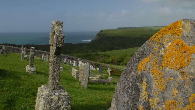 T/L track across lichen covered tombstones, St. Genny's churchyard, Cornwall, UK,