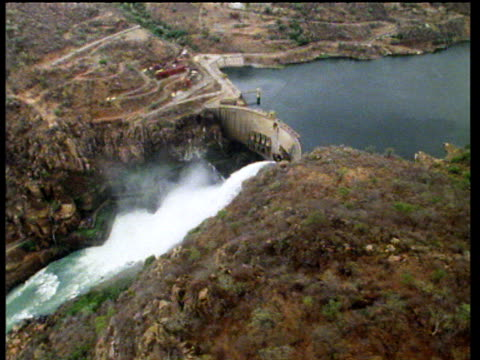 Track along Cahora Bassa dam gushing water from the River Zambezi; Mozambique