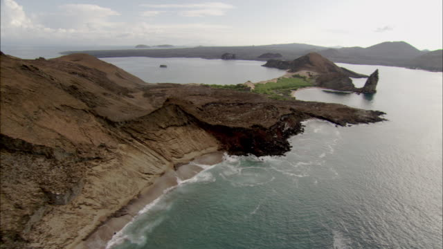 track along coast of isla bartolome available in hd. - galapagos islands stock videos & royalty-free footage