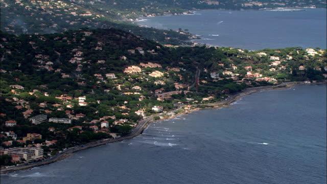 track along coastline by saint-maxime  - aerial view - provence-alpes-côte d'azur, var, france - var stock videos & royalty-free footage