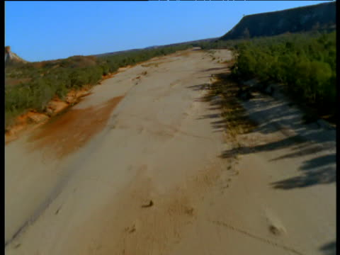 track along dry bed of finke river, northern territory, australia - dry stock videos & royalty-free footage