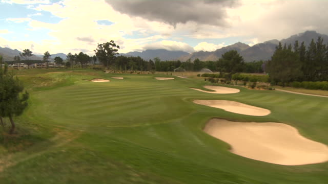 track along golf course, paarl, south africa available in hd. - paarl stock videos & royalty-free footage