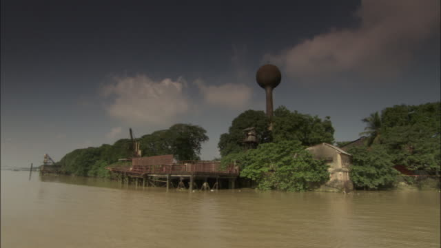 track along hooghly river past crane and tower on river bank, kolkata available in hd. - kolkata stock videos & royalty-free footage