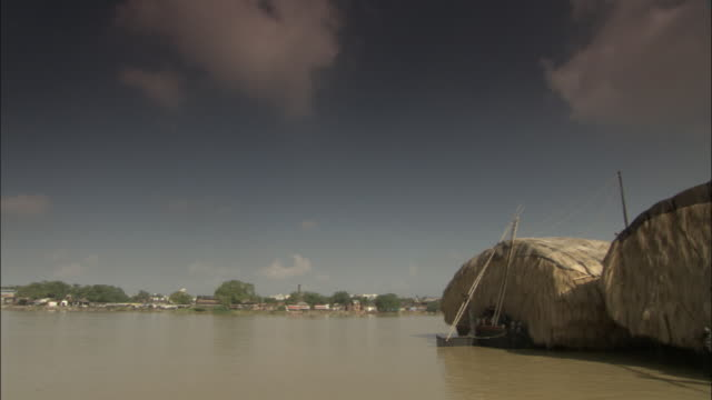 track along hooghly river past huge straw barges, kolkata available in hd. - hooghly river stock videos & royalty-free footage