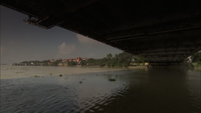 track along hooghly river under howrah bridge, kolkata available in hd. - howrah bridge stock videos and b-roll footage