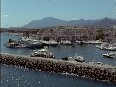 vidéos et rushes de track along marina and breakwater marbella spain - style des années 2000