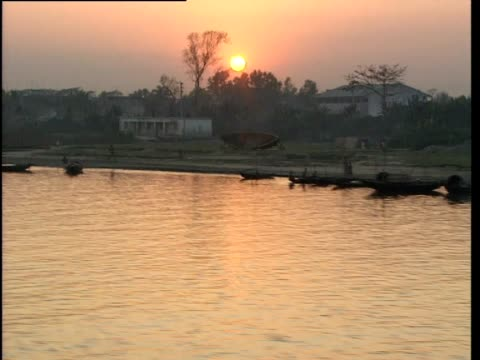 track along river at sunset - bangladesh stock videos & royalty-free footage