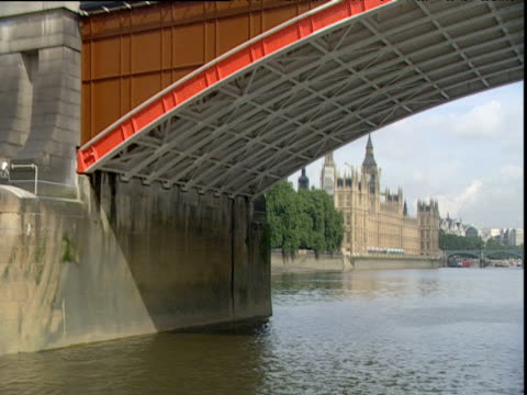 track along river thames under lambeth bridge towards palace of westminster london - lambeth stock videos & royalty-free footage