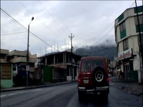 track along run down city road following behind 4x4 quito ecuador - ecuador stock videos and b-roll footage