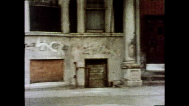 track along run-down city street in chicago; 1976 - slum stock-videos und b-roll-filmmaterial