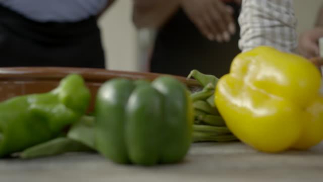 track along table of paella ingredients - schneidebrett stock-videos und b-roll-filmmaterial