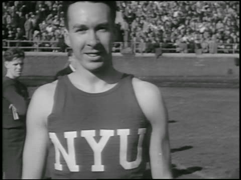 track and field athlete in nyu shirt smiling at camera / evanston, illinois / newsreel - anno 1934 video stock e b–roll