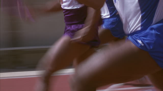 track and field athletes running in a relay race. - loss stock videos & royalty-free footage