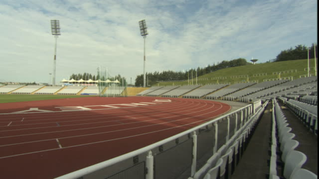 ws pan track and seats in empty sports stadium/ sheffield, england - no people stock videos & royalty-free footage
