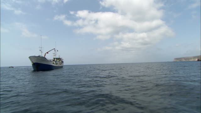 track around a fishing boat in the mediterranean sea. available in hd. - anchored stock videos & royalty-free footage