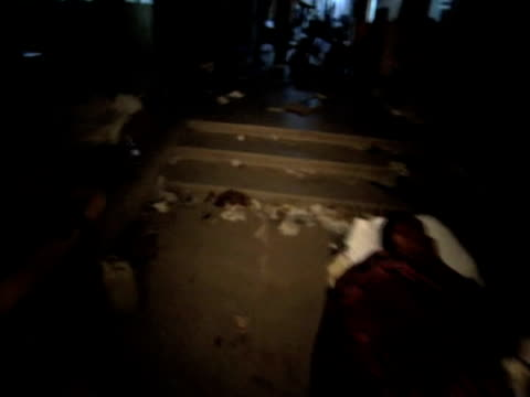 track around grounds of hospital as injured victims await medical treatment following devastating earthquake port au prince haiti; 14 january 2010 - port au prince stock videos & royalty-free footage