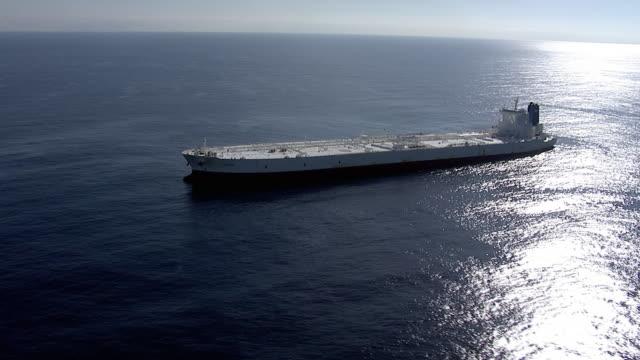 track around huge oil supertanker, pacific ocean - oil industry stock videos & royalty-free footage
