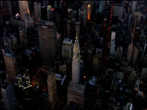 track around illuminated spire of chrysler building manhattan - 2002 stock-videos und b-roll-filmmaterial