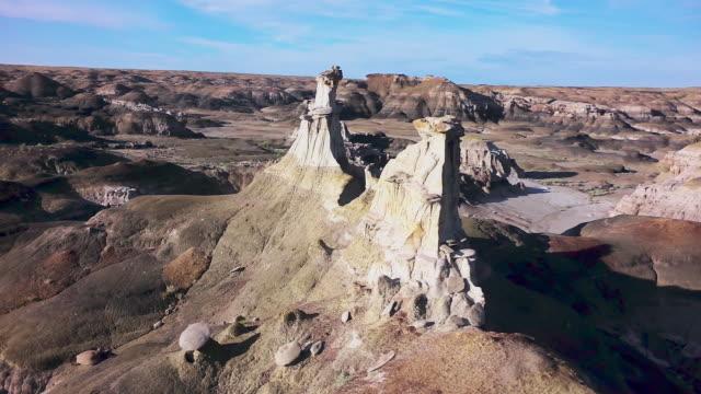ms aerial track around pinnacle rock formations - bisti badlands stock videos & royalty-free footage