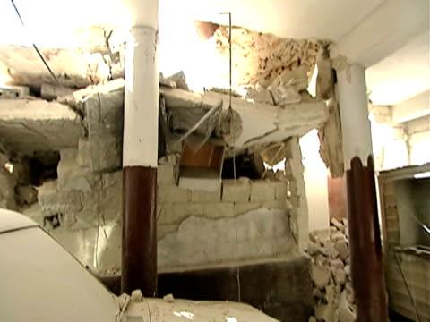 vídeos de stock e filmes b-roll de track around remains of house following devastating earthquake haiti 14 january 2010 - hispaniola