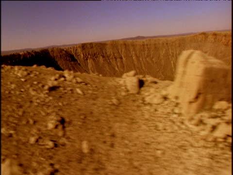 track around rim of barringer meteorite crater arizona - impact stock videos & royalty-free footage