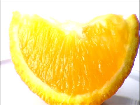track around slice of orange - slice stock videos and b-roll footage
