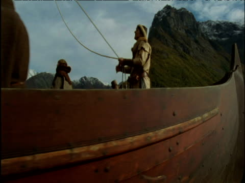 track around viking fishing boat in fjord norway - viking stock videos and b-roll footage