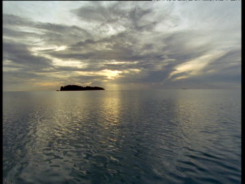 track away from aitutaki island over ocean - aitutaki stock videos & royalty-free footage